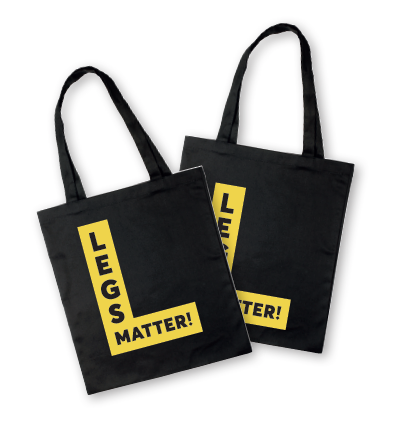 Black Legs Matter tote bags with yellow logos